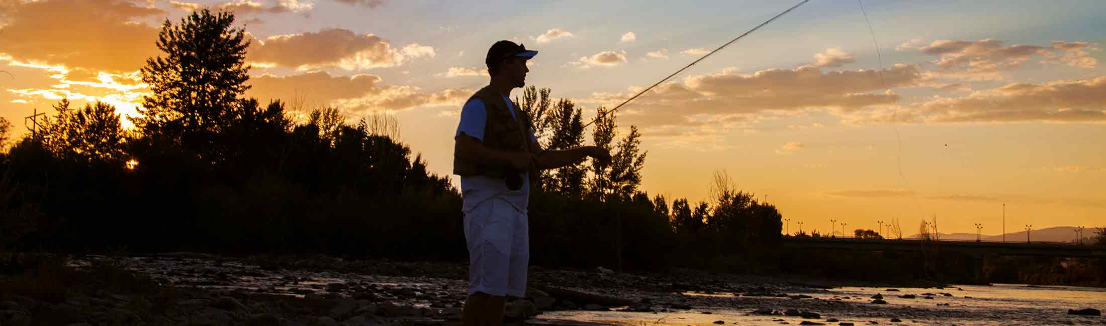 A Fisherman on the Clark Fork River during sunset